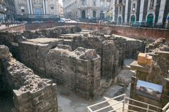 Remains of the Roman amphitheatre in the historic centre of Catania, Sicily island, Italy Stock Photos