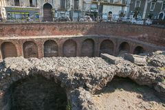 Remains of the Roman amphitheatre in the historic centre of Catania, Sicily island, Italy Stock Images