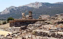 Remains of Roman civilization. Formed by columns in the ruins of Baelo Claudia in the Spanish province of Cadiz, are the mountains in the background Stock Images