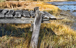 Remains of a rotting pier in Maine Stock Photo