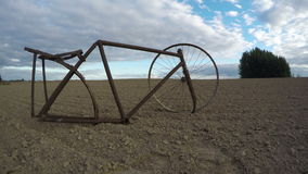 Remains of rusty bicycle in the field, time lapse 4K stock footage