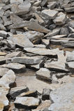 Remains of a stone with water. Crushed stone in a river Royalty Free Stock Photo