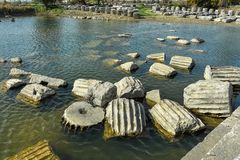 Remains of temple pillars in a pond. In the sanctuary of Letoon Stock Photography