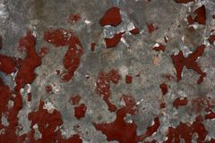 Remains of torn off red paint. On the wall Stock Images
