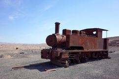 Humberstone Saltpeter Worksm in northern Chile. The remains of a train in the abandoned Humberstone saltpeter works. This abandoned nitrate town was extremely stock photo