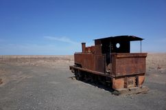 Humberstone Saltpeter Worksm in northern Chile. The remains of a train in the abandoned Humberstone saltpeter works. This abandoned nitrate town was extremely royalty free stock image