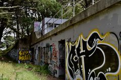 The remains of West Fort Miley beautified under graffiti, 18. By 1885 it was apparent the new West Coast of the United States needed fortification. It took the Royalty Free Stock Photo