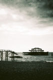 Remains of the west pier on brighton beach, England Royalty Free Stock Images