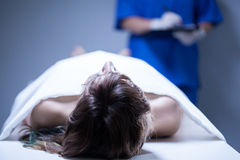 Remains of woman. Closeup of remains of woman lying in morgue Stock Photography
