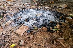 Remains of wood coal and ashes after the combustion of firewood.Burned charcoal and ash from fire.Coal and wood ashes.  stock photography