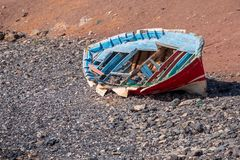 Remains of a wooden fishing boat on the coast of the Canary Isla royalty free stock photos