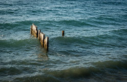 Remains of a wooden Pier or Jetty on a calm sea Royalty Free Stock Images