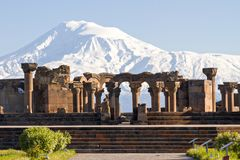 Mount Ararat and the ruins of the Zvartnots Cathedral in Yerevan, Armenia. Remains of the Zvartnots cathedral with the Ararat Mountain in the background in Royalty Free Stock Image