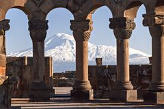Mount Ararat and the ruins of the Zvartnots Cathedral in Yerevan, Armenia. Remains of the Zvartnots cathedral with the Ararat Mountain in the background in Royalty Free Stock Photo
