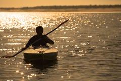 Remando al tramonto Fotografia Stock
