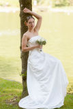 Remarkable bride spend free time in nature stock photography