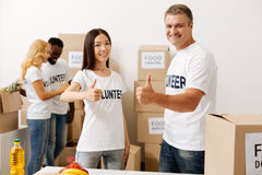 Remarkable men and women making their contribution to community. Improving the world. Charming altruistic clever people dedicating their time to volunteering and Royalty Free Stock Image