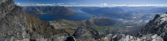 Remarkable Panorama. Panoramic shot of Queenstown and Lake Wakatipu from top of the Remarkables mountain range Stock Photo