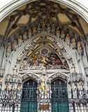 The remarkable sculpture, the Last Judgment, carved over the main entrance of St. Vincent Cathedral Munster Kirche at Munsterpla stock image
