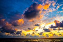 Remarkable sunset sky near ocean. Dramatic Colorful beautiful cloudy sky at sunset Stock Photo