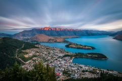 The Remarkables Mountain burning with a red light at sunset in Queenstown, NZ stock images