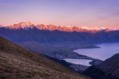 The Remarkables mountain and Lake Wakatipu at dusk. New Zealand Stock Photos