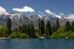 Remarkables mountains. From the lake in Queenstown, a view on the Remarkables mountains behin the park Stock Photos