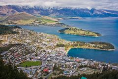 Remarkables mountains behind Wakatipu lake in Queenstown, NZ. Remarkables mountains and Wakatipu lake in Queenstown, New Zealand stock image