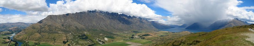 The Remarkables, New Zealand. Panoramic shot of the Remarkables and Lake Manapouri, Queenstown, New Zealand Stock Photo