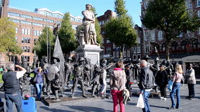 Rembrandtplein (Rembrandt Square) in Amsterdam, Ne. AMSTERDAM - SEP 11: Visitors near sculptures of the Night Watch in 3D at the Rembrandtplein (Rembrandt Square stock video