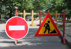 Remedial maintenance. Two road signs: remedial maintenance and do not enter Stock Images