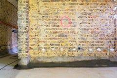Remediation av tegelstenväggen royaltyfri foto
