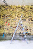 Remediation of brick wall and ladder Royalty Free Stock Image