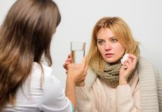 Remedies should help beat cold fast. Tips how to get rid of cold. Woman consult with doctor. Girl in scarf hold tissue. While doctor offer treatment. Cold and royalty free stock photos
