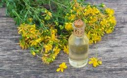 Remedy St. John s wort flower in a glass bottle Stock Photo