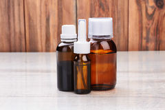 Remedy vials on wooden surface. Stock Photography