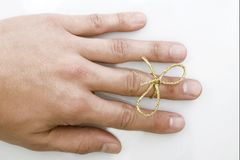 Remember. Concept, caucasian hand with gold tie Royalty Free Stock Image