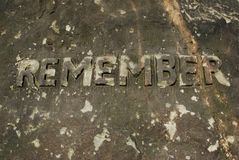 Remember. Word remember written on a tombstone Royalty Free Stock Photography