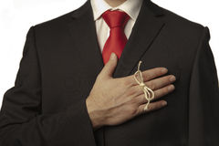 Remember. Man in buisness suit with a knot around his finger to make him remember something Stock Photos