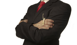 Remember. Man in buisness suit with a knot around his finger to make him remember something royalty free stock image
