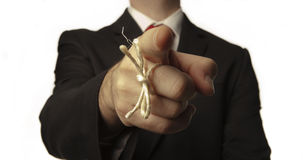 Remember. Man in buisness suit with a knot around his finger to make him remember something Stock Image