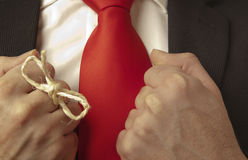 Remember. Man in buisness suit with a knot around his finger to make him remember something Royalty Free Stock Photos