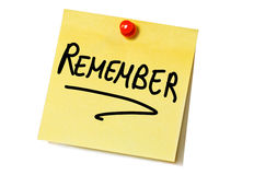 Remember. Post-it reminding to do something Royalty Free Stock Image