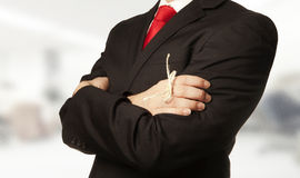 Remember. Man in business suit with a knot around his finger to make him remember something stock photo