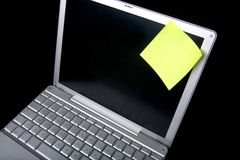 Remember. A sticky note on a laptop computer - remember this Royalty Free Stock Photo