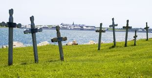 Remember the fallen heroes. Old seaside cemetary with a historic fort in the distance Stock Images