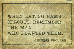 Remember man CP. When eating bamboo sprouts, remember - ancient Chinese proverb printed on grunge vintage cardboard Stock Photo