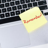REMEMBER NOTE. Sticked on laptop Royalty Free Stock Image