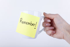 REMEMBER NOTE. Sticked on white cup Royalty Free Stock Image