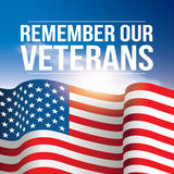Remember Our Veterans poster, banner USA, American flag background against the blue sky.  Royalty Free Stock Image